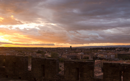 Spectacular sunset in Carcassonne. View from medieval village on town in bottom. Horizontal full frame crop Stock Photo