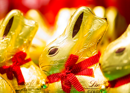 Easter bunny Lindt chocolate on shelves in supermarket for sale wrapped in golden foil. Lindt & Spr�ngli  produces the highest quality premium chocolate in high ethical and sustainability standards. 13 March 2017.