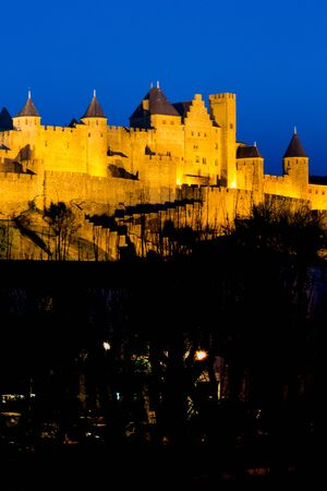 Medieval village Carsassonne in France night view with illuminated wall. Vertical full frame orientation