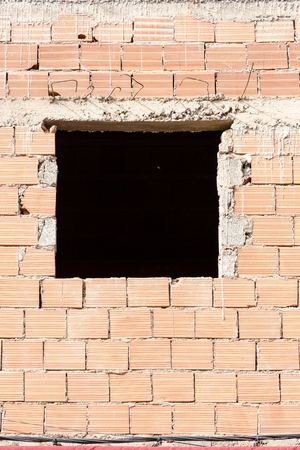 concealment: Window gap in raw building house. Black hole direct view. Vertical ful frame crop