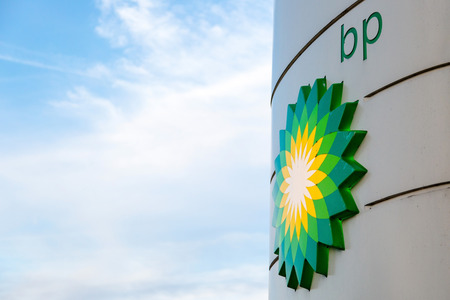 BP display stand with company redesign logo at petrol station in Woking, Surrey, UK. State per 06052016