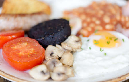 Full English breakfast on plate served in restaurant. Horizontal macro crop Stock Photo