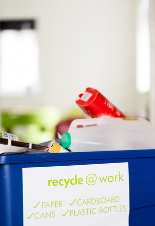Blue recycling bin for recycle at work Close up low anlge view with shallow depth of field Stock Photo