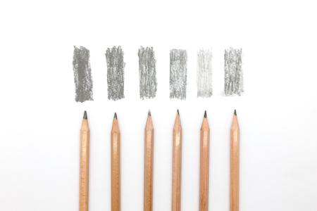Group of pencils samples with different types of graphite, 8B, 3B, HB, H, 4H, F. Close up isolated horizontal crop