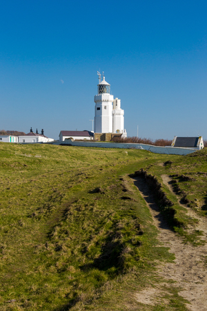 St Catherines Lighthouse on Isle of Wight at Watershoot Bay in England. Landscape view travel shoot in sunny day with clear blue sky