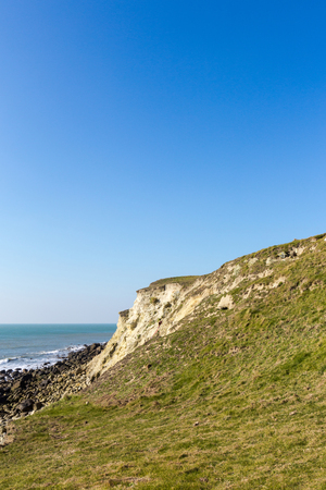 Isle of Wight landscape, St Catherines Lighthouse area in sunny day, with bright green grass andclear blue sky