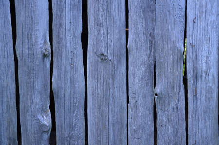 painted wood: Old blue wooden wall of vertical boards