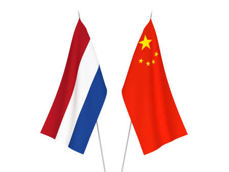 National fabric flags of China and Netherlands isolated on white background. 3d rendering illustration. Foto de archivo