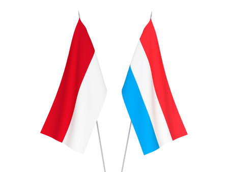 National fabric flags of Luxembourg and Indonesia isolated on white background. 3d rendering illustration. Imagens