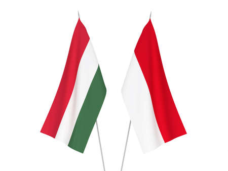 National fabric flags of Indonesia and Hungary isolated on white background. 3d rendering illustration. Imagens