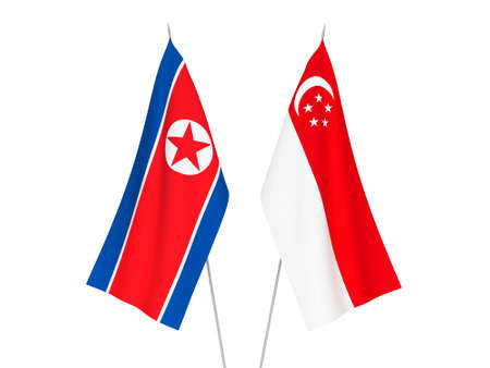 National fabric flags of Singapore and North Korea isolated on white background. 3d rendering illustration. Stock Photo