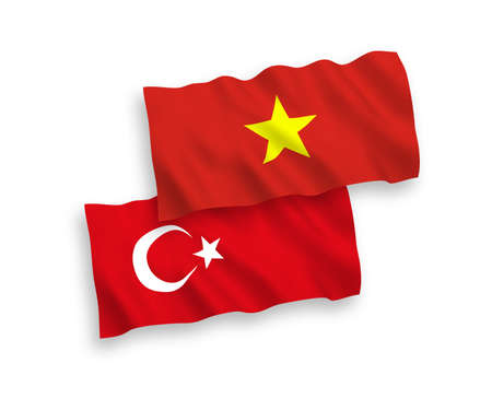 National vector fabric wave flags of Turkey and Vietnam isolated on white background. 1 to 2 proportion.