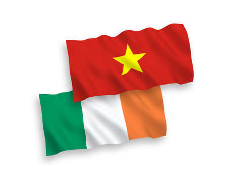 National vector fabric wave flags of Ireland and Vietnam isolated on white background. 1 to 2 proportion. Illustration