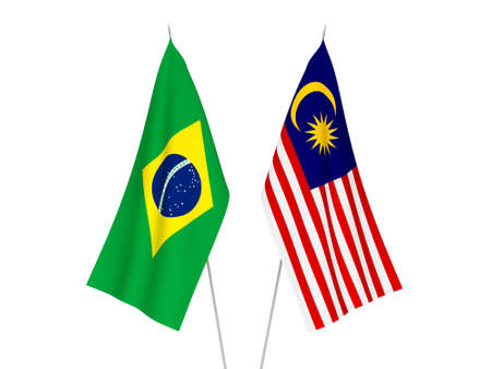 National fabric flags of Brazil and Malaysia isolated on white background. 3d rendering illustration. Фото со стока