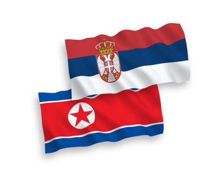 National vector fabric wave flags of North Korea and Serbia isolated on white background. 1 to 2 proportion.