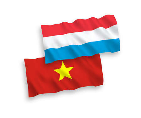 National vector fabric wave flags of Vietnam and Luxembourg isolated on white background. 1 to 2 proportion. Stock Photo - 133557584