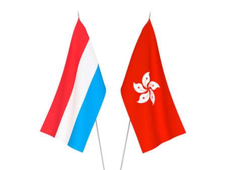 National fabric flags of Luxembourg and Hong Kong isolated on white background. 3d rendering illustration. Фото со стока