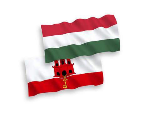 National vector fabric wave flags of Gibraltar and Hungary isolated on white background. 1 to 2 proportion. Stock Photo - 133740701