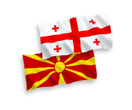 National vector fabric wave flags of North Macedonia and Georgia isolated on white background. 1 to 2 proportion.