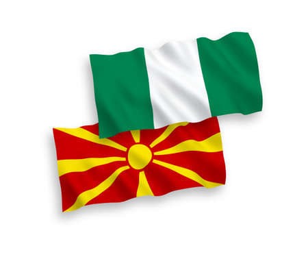 National vector fabric wave flags of North Macedonia and Nigeria isolated on white background. 1 to 2 proportion. Standard-Bild - 136592879
