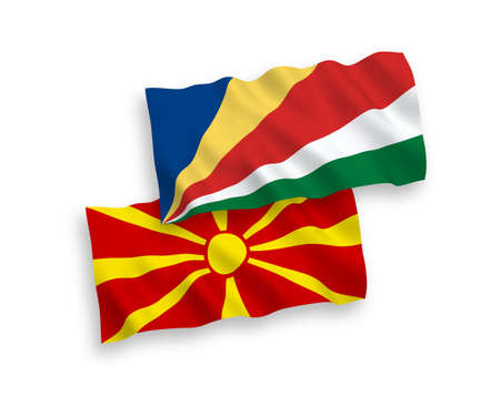 National vector fabric wave flags of Seychelles and North Macedonia isolated on white background. 1 to 2 proportion.