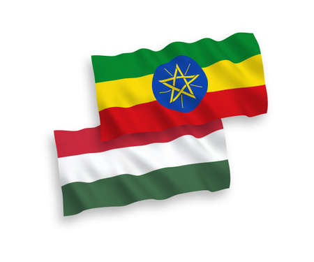 National vector fabric wave flags of Ethiopia and Hungary isolated on white background. 1 to 2 proportion.