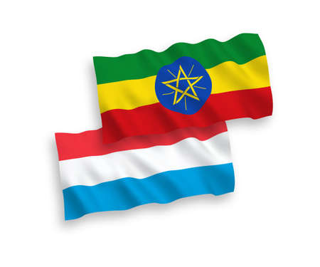 National vector fabric wave flags of Ethiopia and Luxembourg isolated on white background. 1 to 2 proportion.