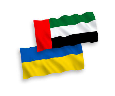 National vector fabric wave flags of United Arab Emirates and Ukraine isolated on white background. 1 to 2 proportion.