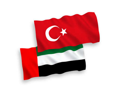 National vector fabric wave flags of Turkey and United Arab Emirates isolated on white background. 1 to 2 proportion.