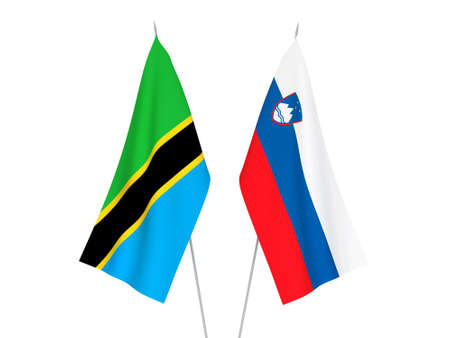 National fabric flags of Slovenia and Tanzania isolated on white background. 3d rendering illustration.