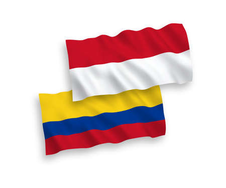 National vector fabric wave flags of Indonesia and Colombia isolated on white background. 1 to 2 proportion.