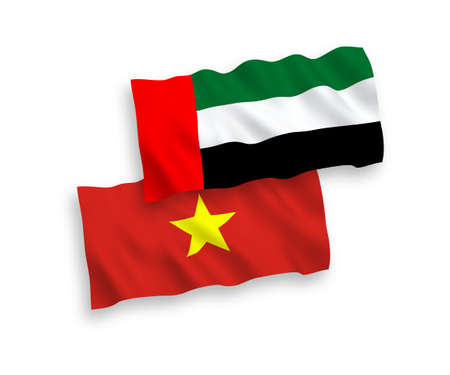 National vector fabric wave flags of United Arab Emirates and Vietnam isolated on white background. 1 to 2 proportion.