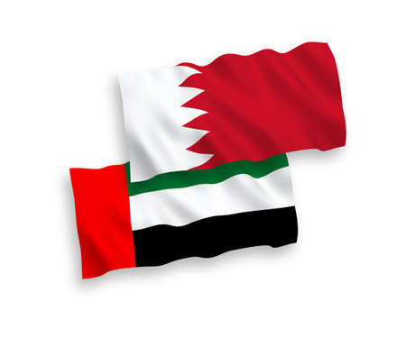 National vector fabric wave flags of United Arab Emirates and Bahrain isolated on white background. 1 to 2 proportion. 向量圖像