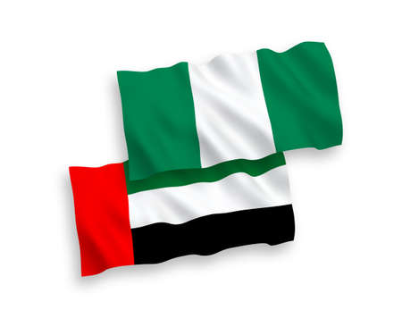 National vector fabric wave flags of United Arab Emirates and Nigeria isolated on white background. 1 to 2 proportion.