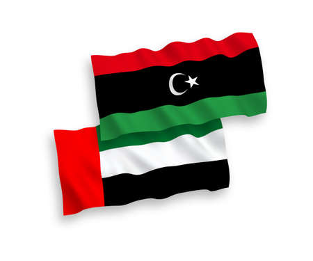 National vector fabric wave flags of United Arab Emirates and Libya isolated on white background. 1 to 2 proportion.