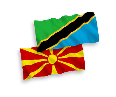 National vector fabric wave flags of Tanzania and North Macedonia isolated on white background. 1 to 2 proportion.