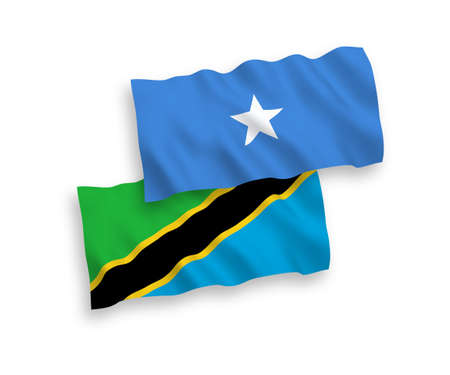 National vector fabric wave flags of Tanzania and Somalia isolated on white background. 1 to 2 proportion.