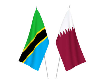 National fabric flags of Tanzania and Qatar isolated on white background. 3d rendering illustration.