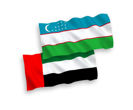National vector fabric wave flags of Uzbekistan and United Arab Emirates isolated on white background. 1 to 2 proportion.