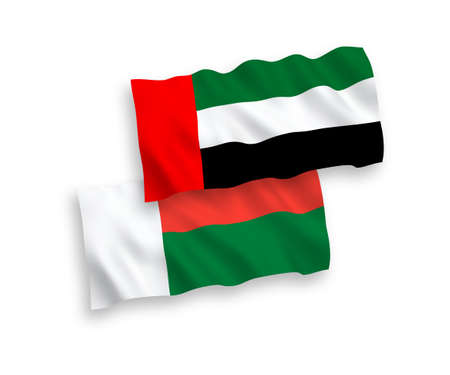 National vector fabric wave flags of Madagascar and United Arab Emirates isolated on white background. 1 to 2 proportion.