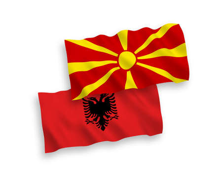 National vector fabric wave flags of Albania and North Macedonia isolated on white background. 1 to 2 proportion.