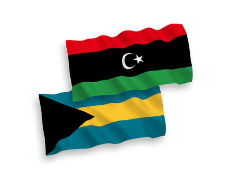 National vector fabric wave flags of Commonwealth of The Bahamas and Libya isolated on white background. 1 to 2 proportion.