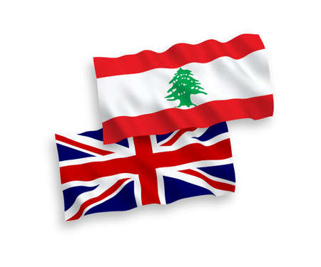 National vector fabric wave flags of Great Britain and Lebanon isolated on white background. 1 to 2 proportion. 向量圖像