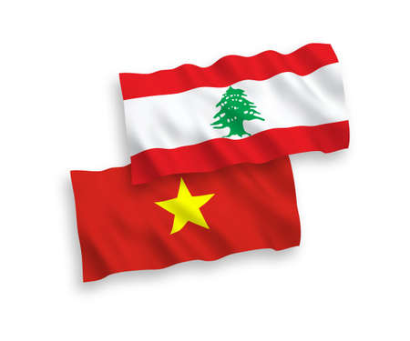 National vector fabric wave flags of Lebanon and Vietnam isolated on white background. 1 to 2 proportion.