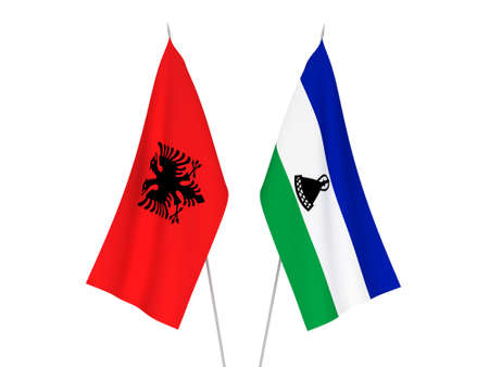 National fabric flags of Republic of Albania and Lesotho isolated on white background. 3d rendering illustration.