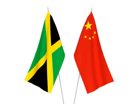 National fabric flags of China and Jamaica isolated on white background. 3d rendering illustration. Foto de archivo - 157456885