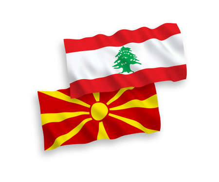 National vector fabric wave flags of Lebanon and North Macedonia isolated on white background. 1 to 2 proportion.