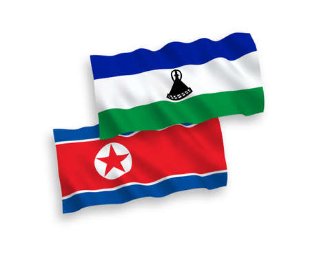 National vector fabric wave flags of North Korea and Lesotho isolated on white background. 1 to 2 proportion. 向量圖像