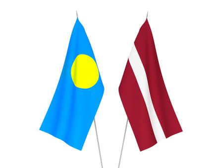 National fabric flags of Latvia and Palau isolated on white background. 3d rendering illustration. Foto de archivo - 157345665