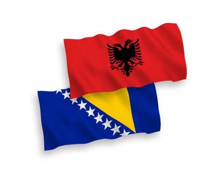 National vector fabric wave flags of Bosnia and Herzegovina and Albania isolated on white background. 1 to 2 proportion. Vectores